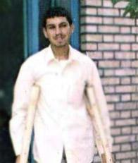 عکس شهید هنگام مجروحیت از ناحیه دو پا در اولین عملیات